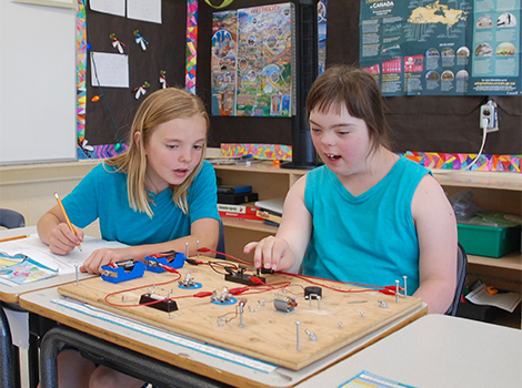 Two students work together in a classroom