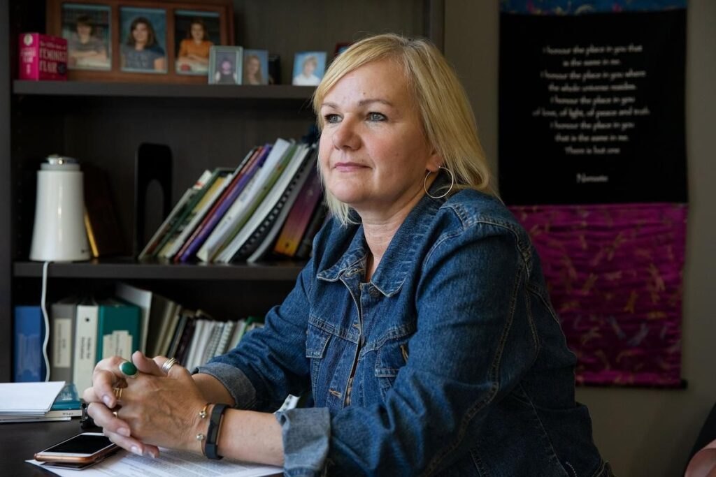 Inclusion Alberta CEO Trish Bowman sitting at desk