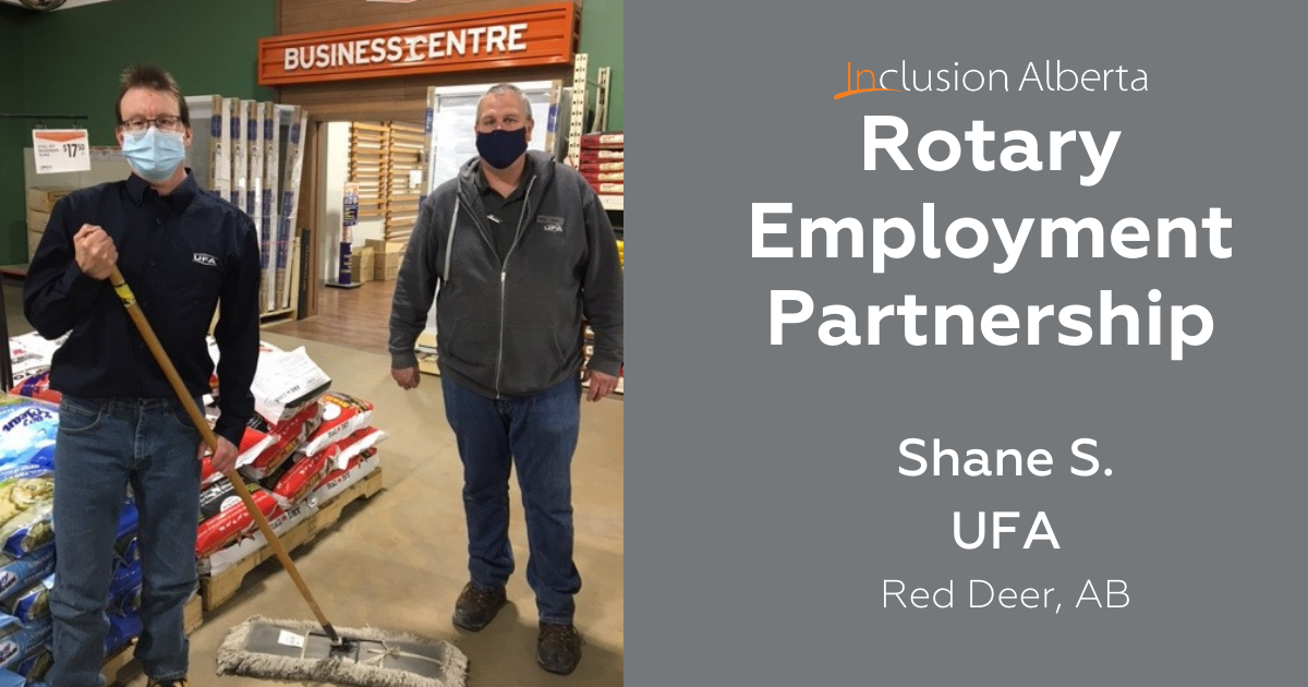 Rotary Employment Partnership, Shane S at UFA Red Deer, AB. Shane poses in a UFA store holding a mop, next to his colleague.